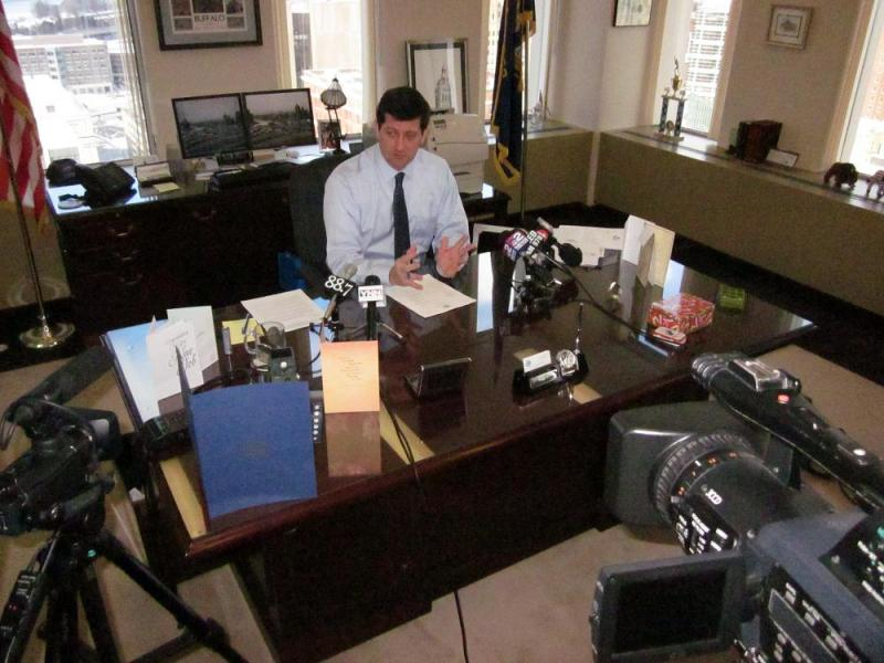 Erie County Executive Mark Poloncarz prepares to sign five executive orders in the first day of his new job.