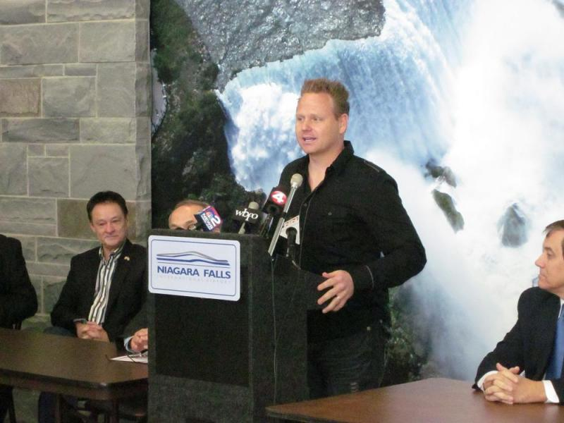 Nik Wallenda speaks to reporters at the Niagara Falls International Airport, one day after Canadian officials gave their approval to his request to hold a high-wire walk over Niagara Falls some time later this year.