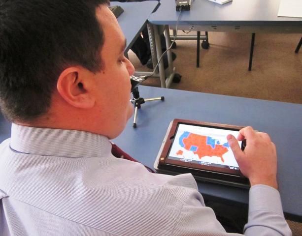 Canisius High School teacher Tom Coppola demonstrates on iPad