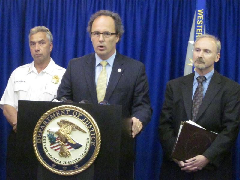 Police Commissioner Daniel Derenda, U.S. Attorney William Hochul and Special Agent-in-Charge Dale Kasprzyk announce Thursday's arrest of a Buffalo Police officer