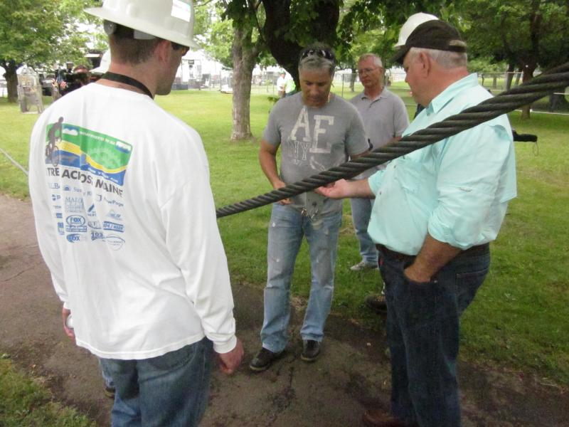 Nik Wallenda's father (right side) talks with crews as they examine the large steel cable wire