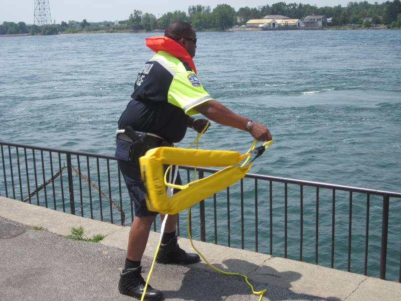 A Buffalo Police Officer demonstrates a new LifeSling flotation device being deployed in the Police Department's fleet of cars.