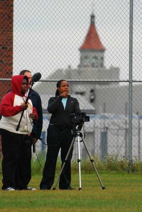 A documentary still shows Teresa Miller filming at the Attica prison.