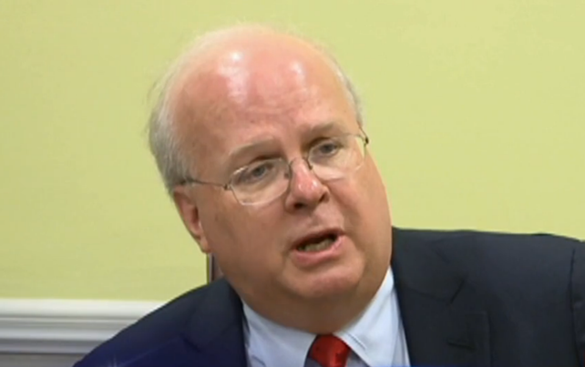 Karl Rove speaks to local reporters while in Buffalo Monday night