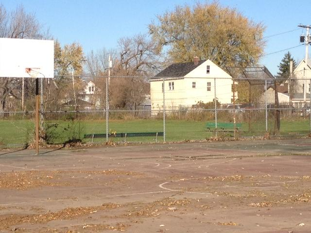 Mulroy Park is an empty field of grass and a worn out basketball court