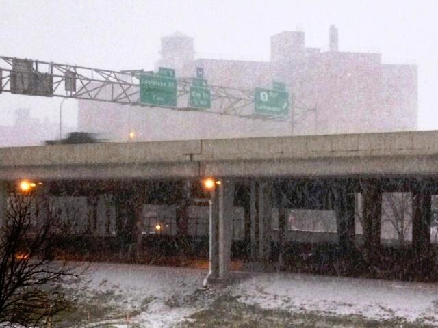 Snow falling in downtown Buffalo along the I-190
