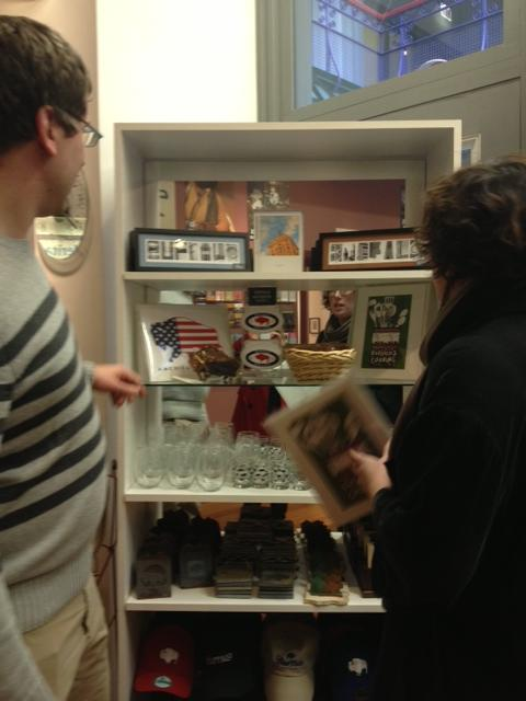Peter Burakowski & Erin Habes look at Buffalo collection items at Visit Buffalo Niagara store at the Market Arcade