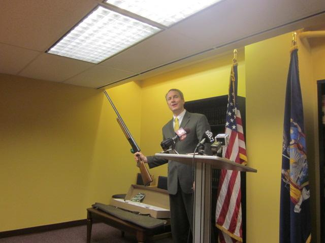 Assembyman Sean Ryan displays his shot gun used for hunting