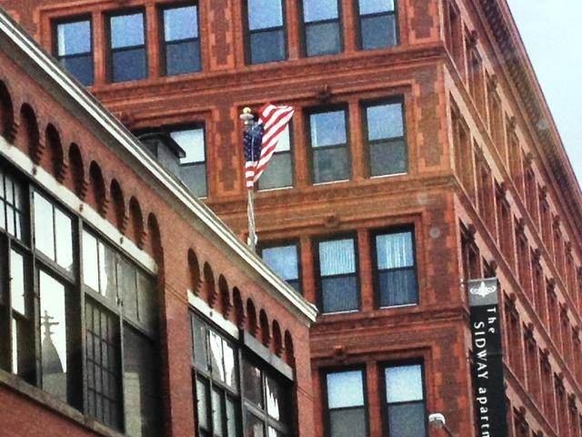 Winds whipped a flag flying above a building at Goodell and Pearl Street in downtown Buffalo Friday morning