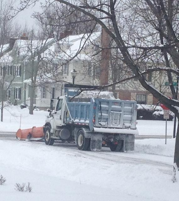Snow plow in Kenmore at Colvin Avenue worknig to remove snow