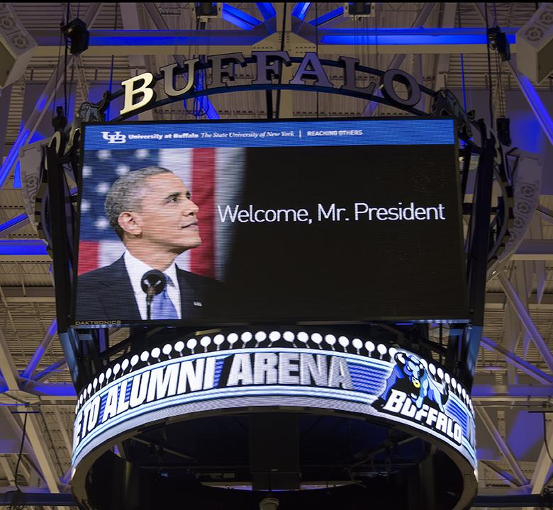 The Alumni Arena Jumbotron displayed a welcoming message to the President