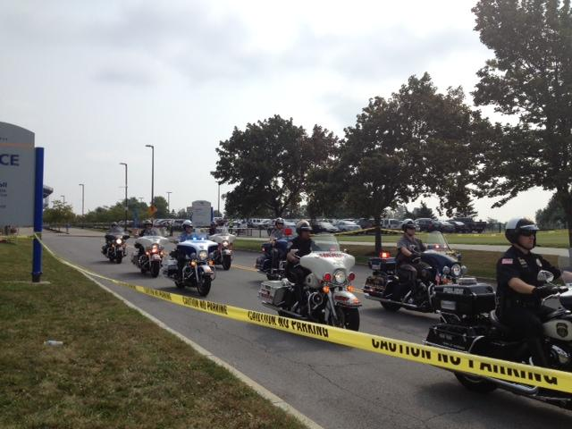 A large police presence escorted the president's bus