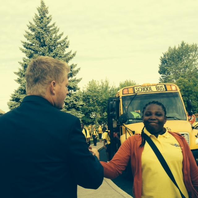CSAT principals high fives student