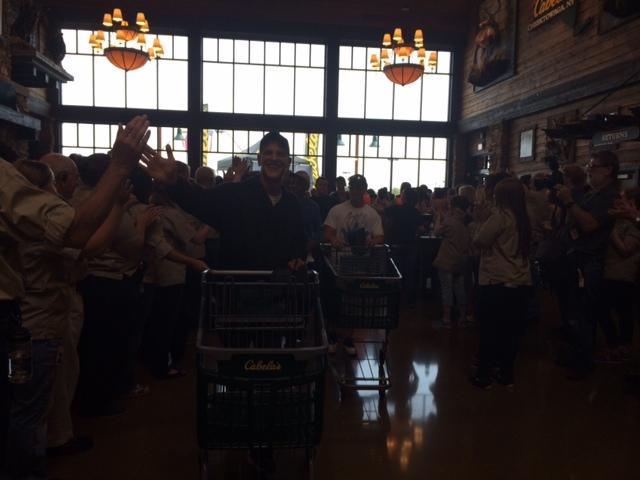 Customers were greeted by cheers from Cabela's 'outfitters.'