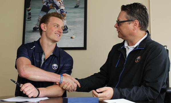 Jack Eichel shook General Manager Tim Murray's hand after signing his entry-level contract.