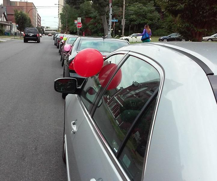 Cars with balloons attached lined High Street and other Buffalo streets not far from the Buffalo Niagara Medical Campus in a Monday morning protest by neighbors who say campus employees are inundating their blocks.