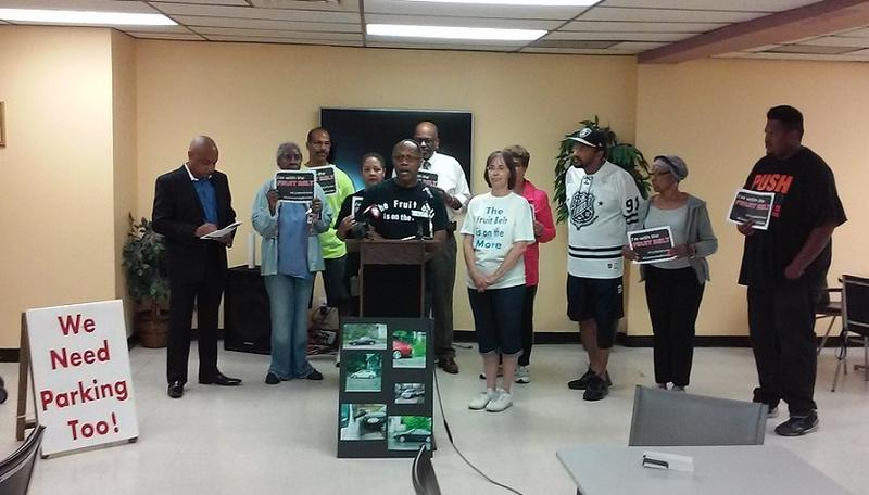 Harvil Hill of the Mulberry Street & Friends Block Club speaks during a Monday morning news conference, during which residents called for a parking permit system for their neighborhoods.