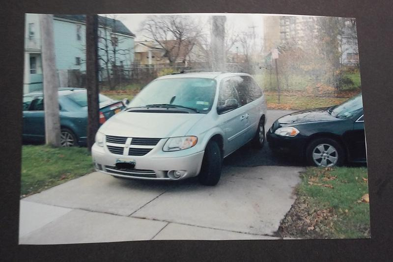 A photo shared by Harvil Hill and Sandy Campbell Hill shows how she needed to negotiate past a parked car to get into her own driveway. Neighbors say this is just one example of the parking congestion caused by medical campus employees and visitors.