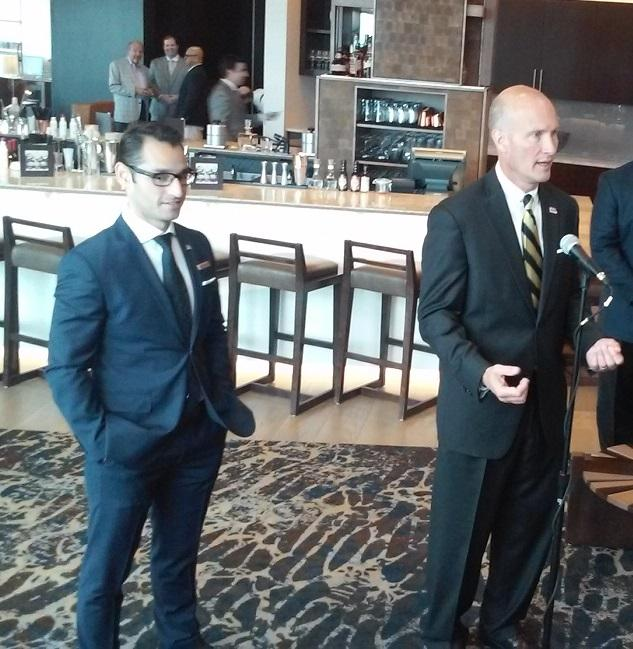 From left to right, hotel general manager Huseyin Taran and Buffalo Sabres executive Stan Makowski answer media questions prior to a tour of the newly-opened Buffalo Marriott HarborCenter