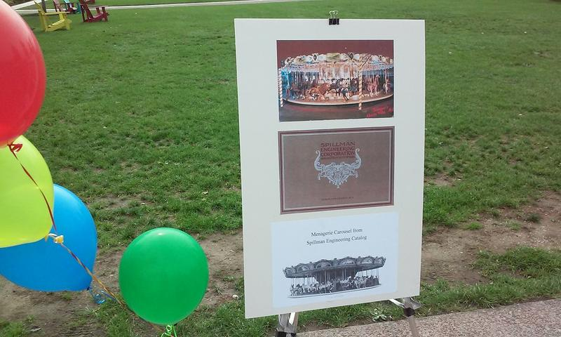 A placard featuring an image of the carousel like the one that will soon be placed in Canalside.