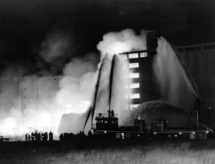 The Buffalo fireboat Edward M. Cotter fighting the Maple Leaf Mills blaze in Port Colborne, after making a nighttime voyage across Lake Erie and the U.S.-Canada border on Oct. 7, 1960.