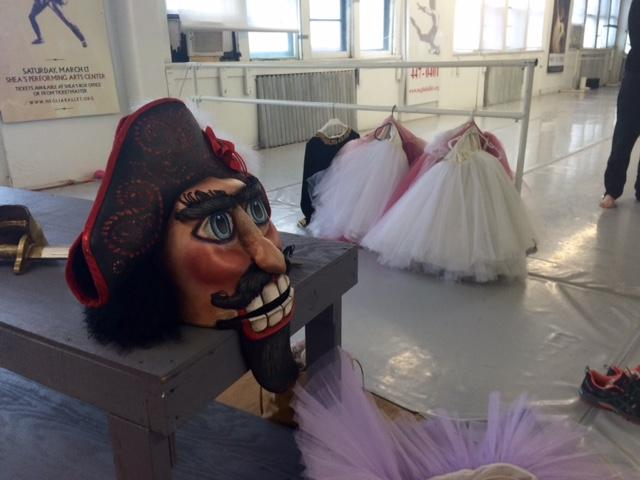Nutcracker head from costume for the show with tutus in the background