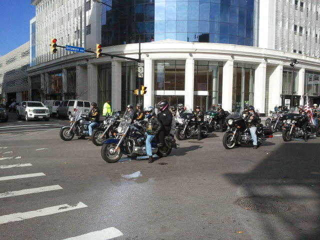 Motorcycle riders roll down Delaware Avenue in the parade
