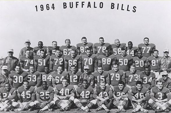 The '64 Bills included Butch Byrd (42), George Saimes (26), Ernie Warlick (84), Jack Kemp (15), Cookie Gilchrist (34), Billy Shaw (66), Tom Sestak (70), Mike Stratton (58) Elbert Dubenion (44) and Stew Barber (77), as well as coach Lou Saban and his staff