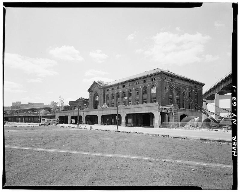 View of DL&W Terminal complex from Main Street looking southeast. Train shed is at far left in photo with two passenger buildings flanking it the larger abutting the elevated skyway at extreme right.