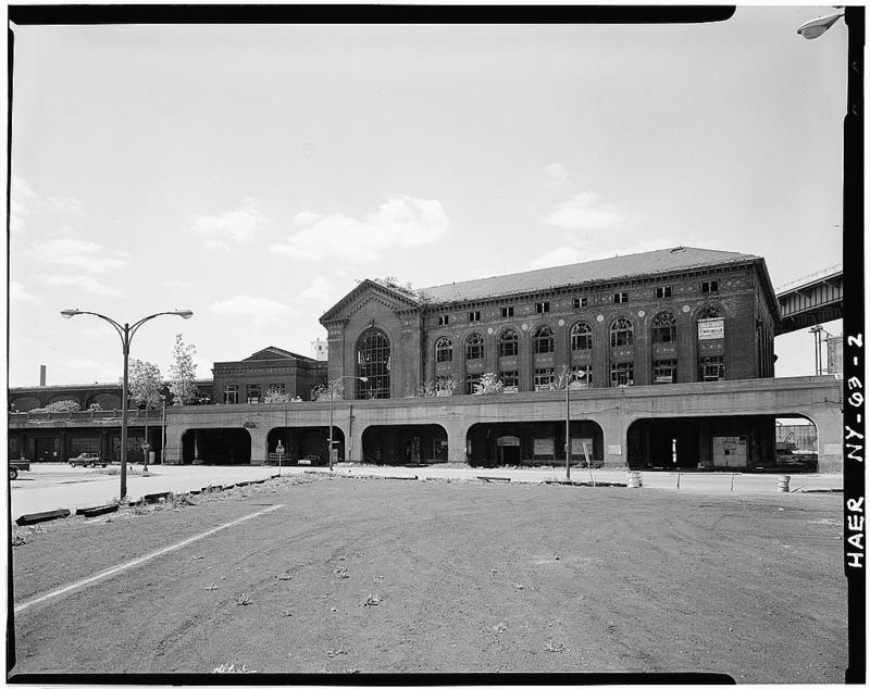 2.Facade of two brick passenger terminal buildings of DL&W from parking lot at the foot of Main Street across South Park Avenue. Arched portion was elevated rail spur which originally continued westward a few hundred yards.