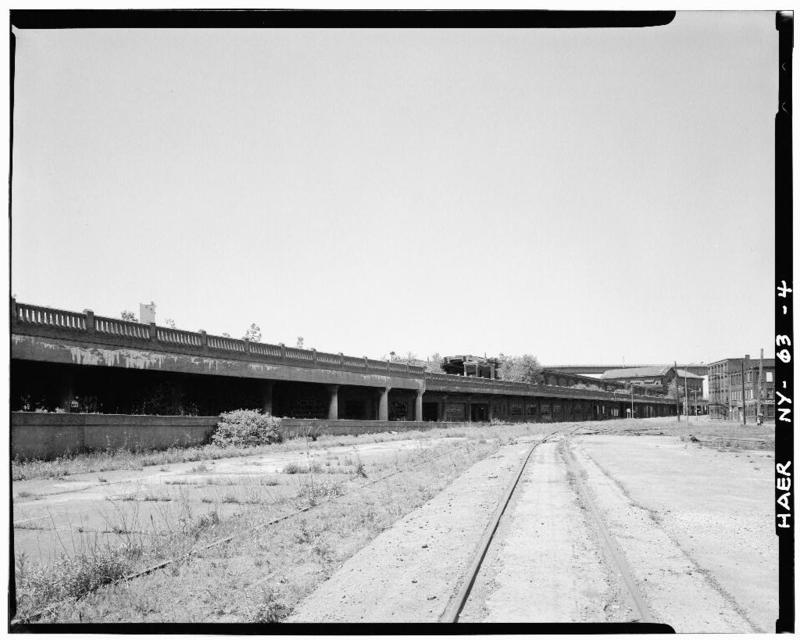 4.View of DL&W terminal site from eastern end of property, to the left of South Park Avenue, showing two-story train shed at right center. Access ramp beginning ascent to second story shows at left, and the larger passenger structure at right.