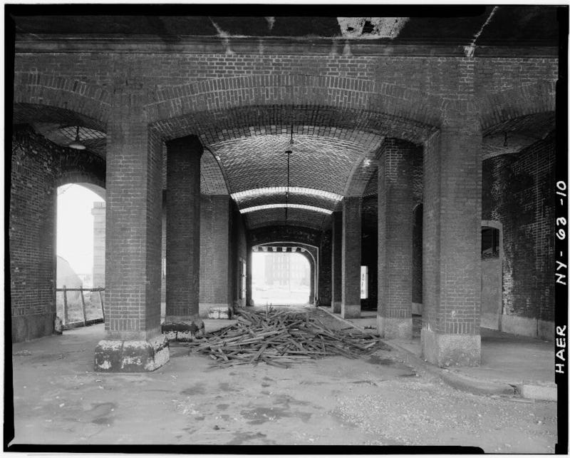 10.Extreme western end of DL&W site with entrance to larger passenger building at right and Naval Park to left. View through tiled archway is to North.