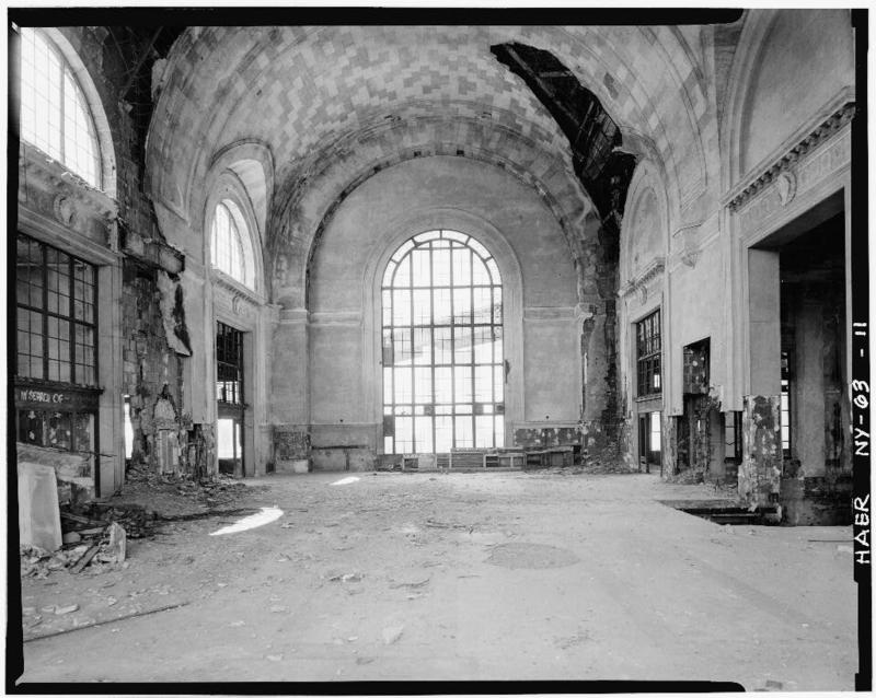 11.Interior of larger DL&W passenger building showing main concourse on upper level, with stairway from street level at right of photo and passage to trains at left. Skyway can be seen through large window facing Buffalo River.