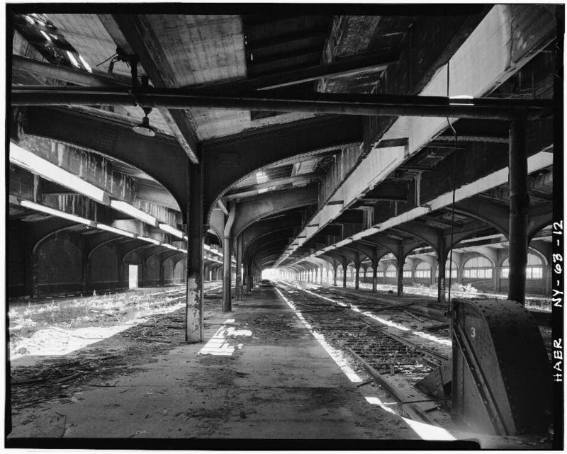 12.Second level of DL&W train shed looking east. Bumper at terminus of track shows right foreground with passenger boarding platform between tracks. This view shows steel and reinforced concrete roof designed by Lincoln Bush.