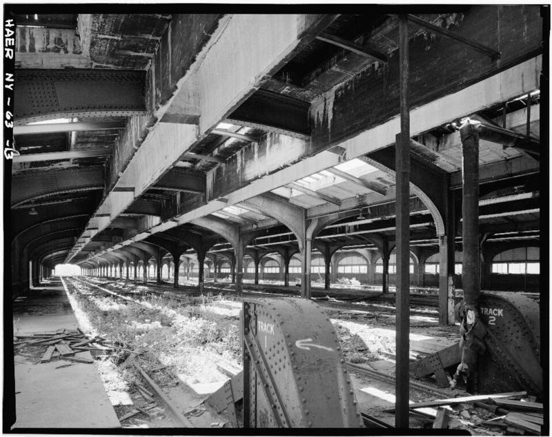 13.Upper level of DL&W train shed looking east. Bumper at track terminus shows in center foreground with passenger boarding platform at left. Steel and reinforced concrete roof designed by Lincoln Bush shows prominently.