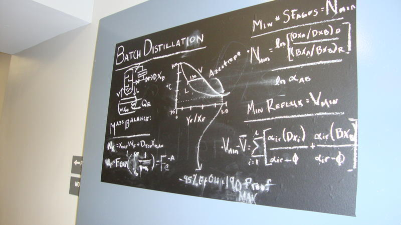 A blackboard at Lockhouse Distillery shows the complicated distilling process.