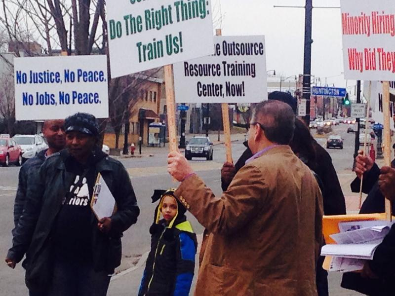 Protestors gathered outside Bennett High School in advance of U.S. Labor Secretary Thomas Perez's visit on March 8.