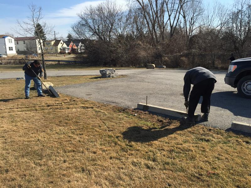 City of Buffalo employees move and repair parking berms at McCarthy Park