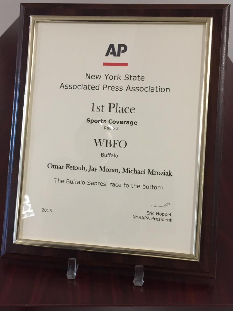 Assistant News Director Omar Fetouh, Morning Edition Host Jay Moran, and Reporter Michael Mroziak received the New York State Associated Press Association's 1st place award for Sports Coverage