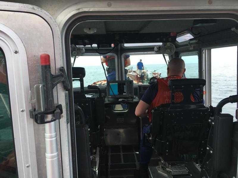 Coast Guard patrol approaches a recreational boater (photo: Elizabeth Miller)