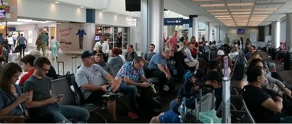 Travelers gathered at their gate inside Buffalo Niagara International Airport, ready to board Jet Blue's first direct flight to Los Angeles.