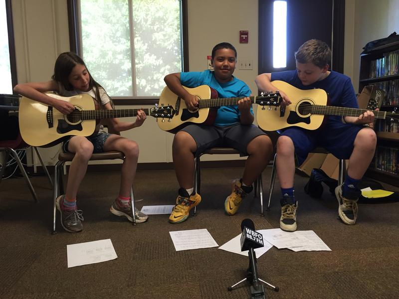 (From left to right) 11 year olds Haley Madigan, Mekhi Hutchins, Griffin McNamara play Neil Young's A Horse With No Name. The three learned how to play guitar at the Valley Community Center.