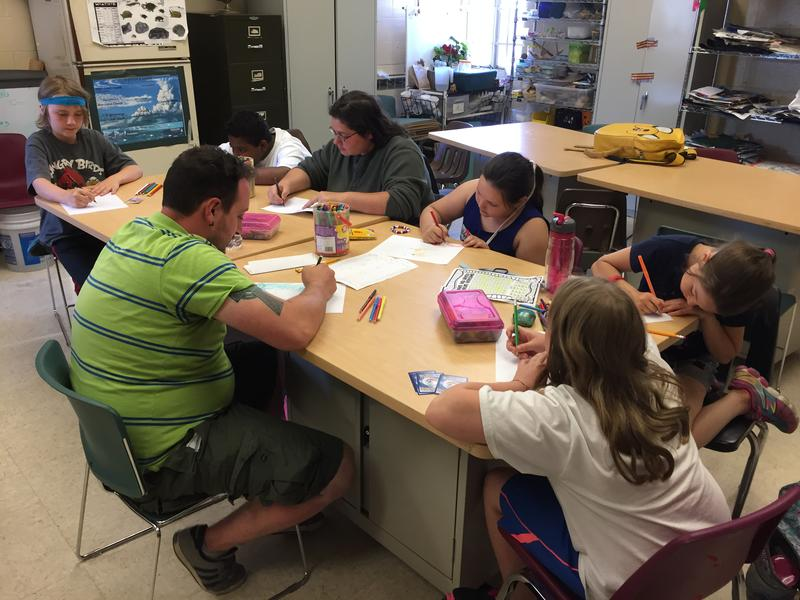 Chidlren draw as part of the Valley Community Center's afterschool activites.