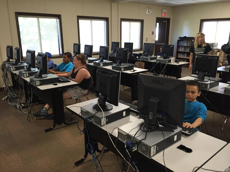 Children play and learn on computers at the Valley Community Center.