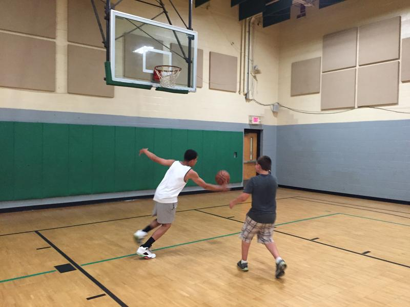 Two boys play basketball in the gym at the Valley Community Center in South Buffalo.