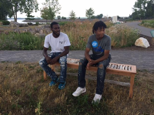 Students use driftwood from Outer Harbor to create benches.