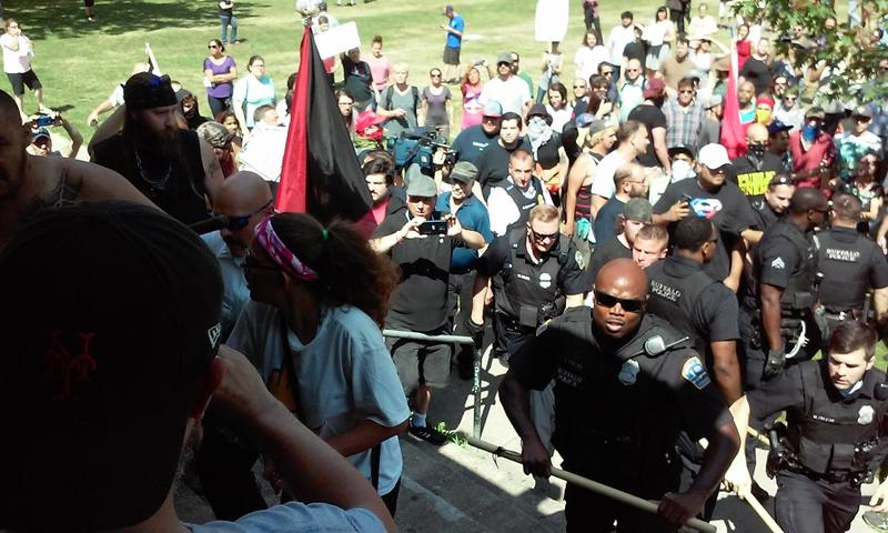 "Buffalo Police work to separate a handful of ""White Lives Matter"" sympathizers from the larger crowd of demonstrators confronting them. One fight broke out, but it was the only violent incident during Saturday's proceedings."