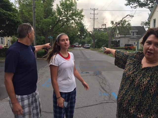 (left to right) Jeff, Gina and Denise Artieri point to their home on Stevens Street, across the street from HTI. They were evacuated from their home Wednesday.cross the street from HTI.
