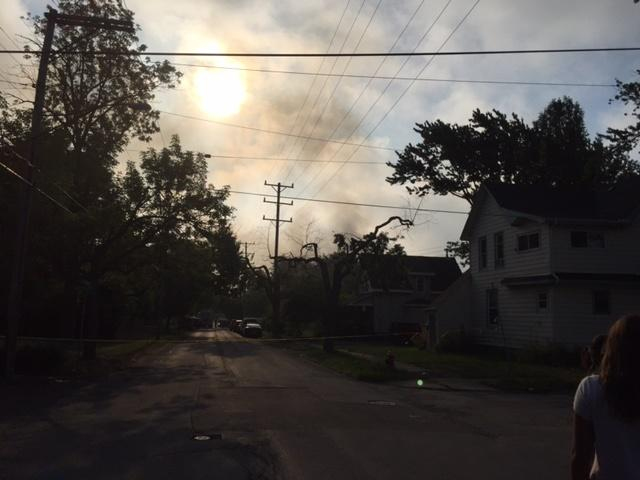 Fire smoke still fills the morning sky Thursday, as fire contained but not under control