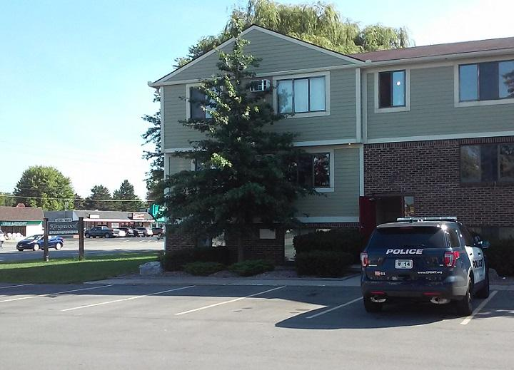A Cheektowaga Police patrol car remained parked outside the apartment complex Friday morning where the bodies of 30-year-old Raina Voll and 7-year-old Leo Klinger were found.